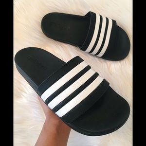 Adidas slides.